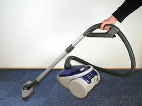Vacuum cleaning carpet tiles and maintenance